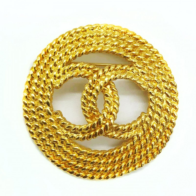 Broche Chanel doré double CC