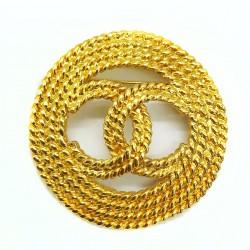 Broche Chanel doré double CC