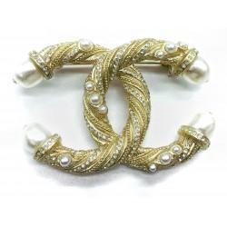 Chanel - Broche métal dorée...